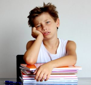 A student sits frustrated in class because he doesn't understand his basic math facts.