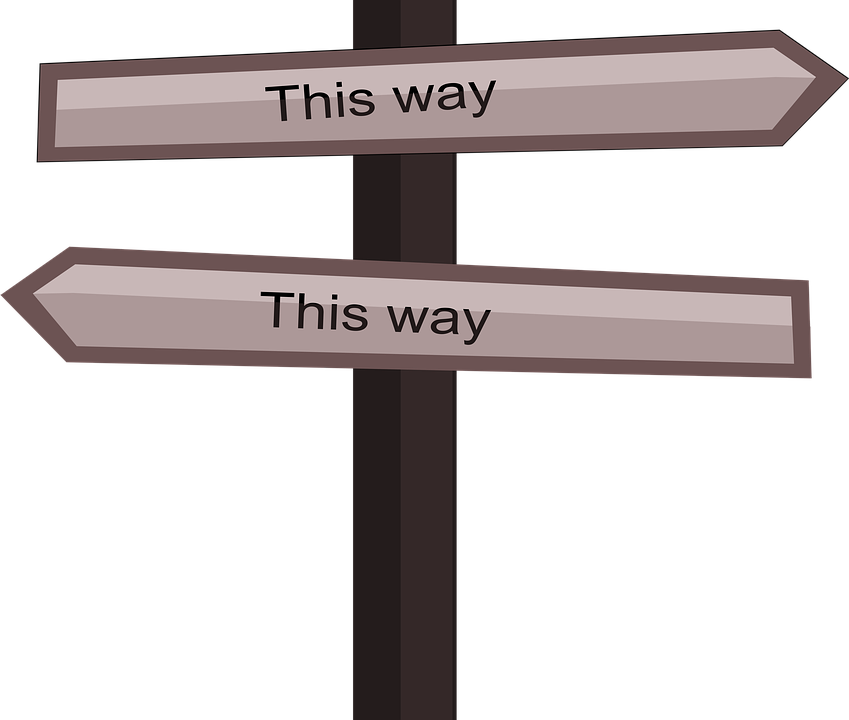 "A road sign with signs pointing ""this way"" and and ""this way"" in opposite directions."