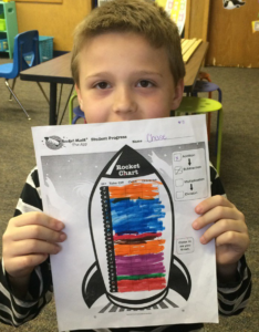 Student with Rocket Chart filled out