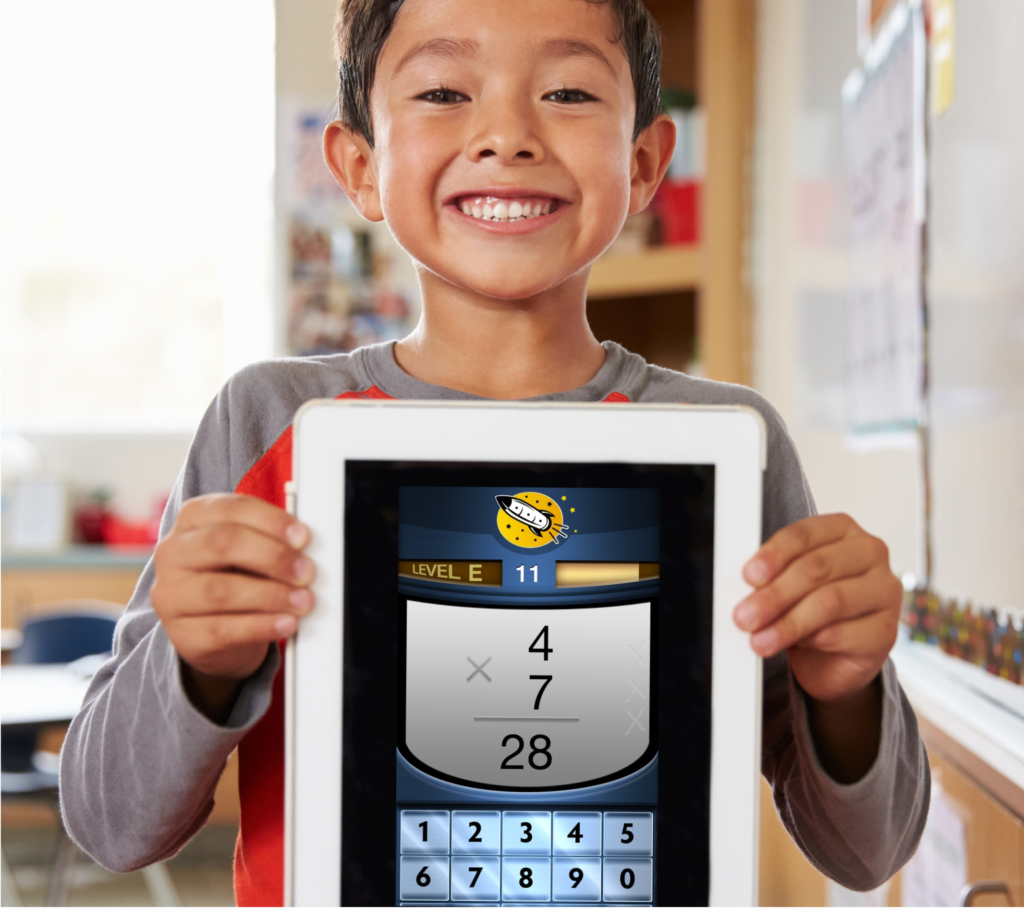 asian child holding tablet with a math fact fluency app by Rocket Math