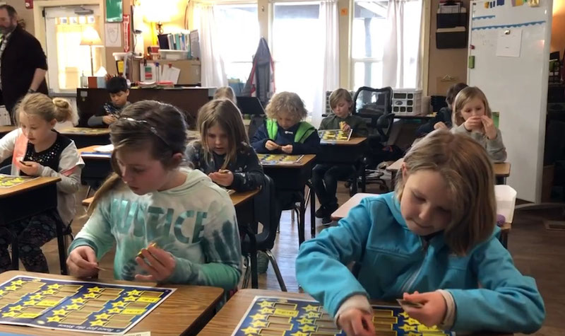 Students in classroom playing Rocket Math's Race for the Stars math fact game