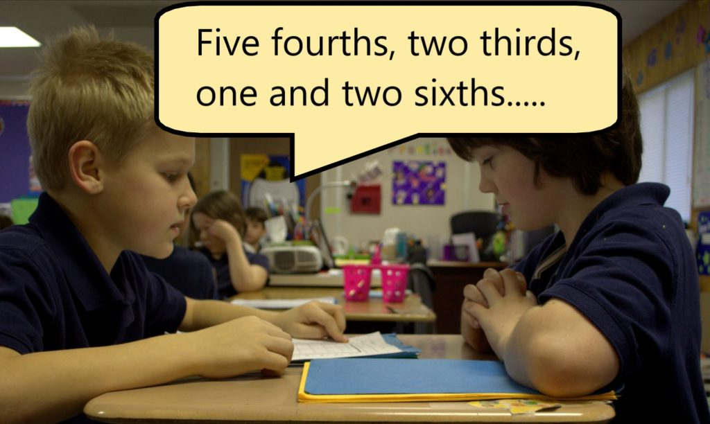 Two students are using 4th grade math worksheets in class by asking each other a math question and testing each other.