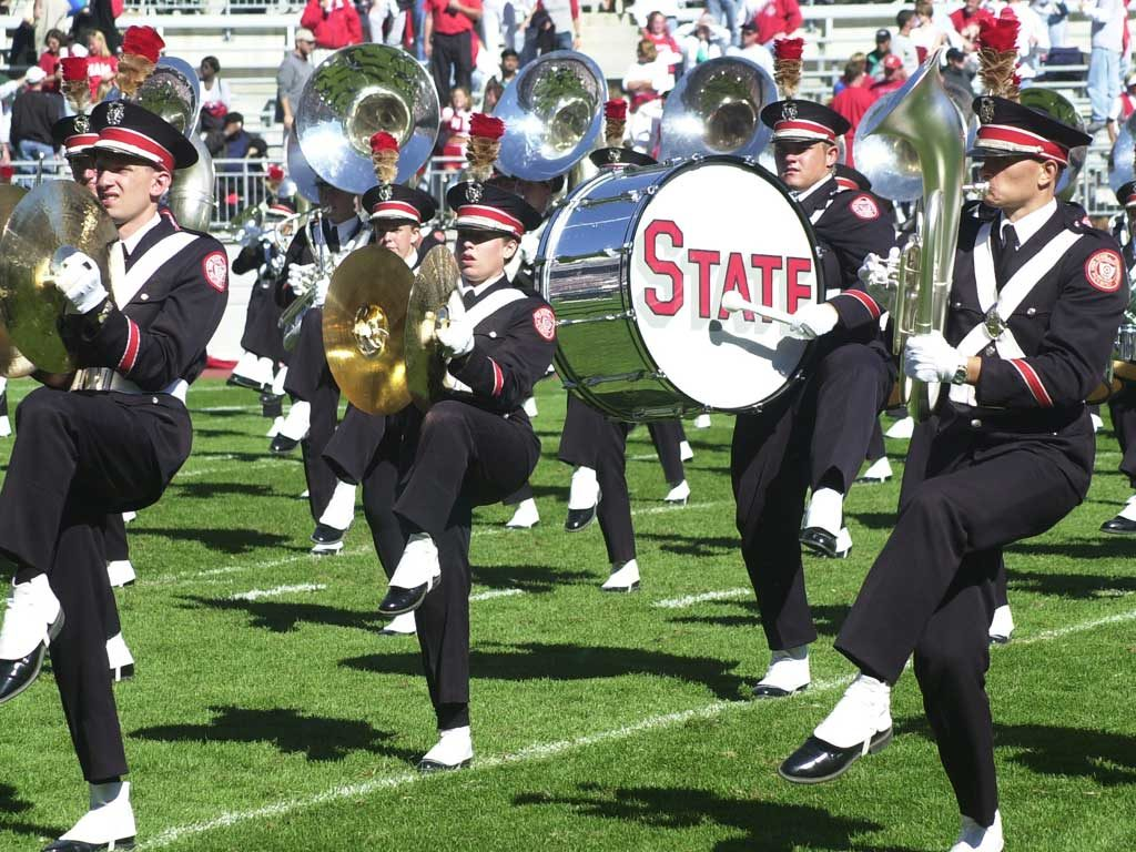 high school marching band with brass instruments and drums