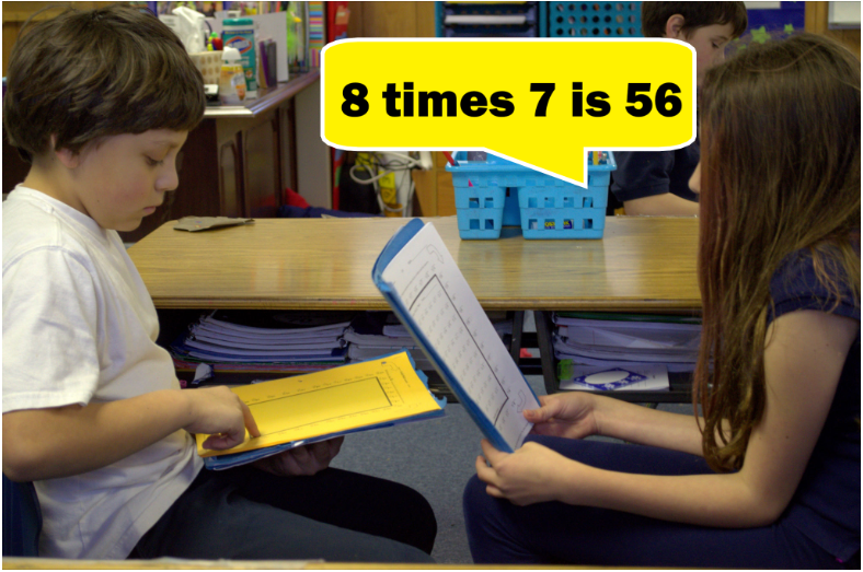 Two students using 4th grade math worksheets practice in class by asking each other questions from Rocket Math's worksheet program.